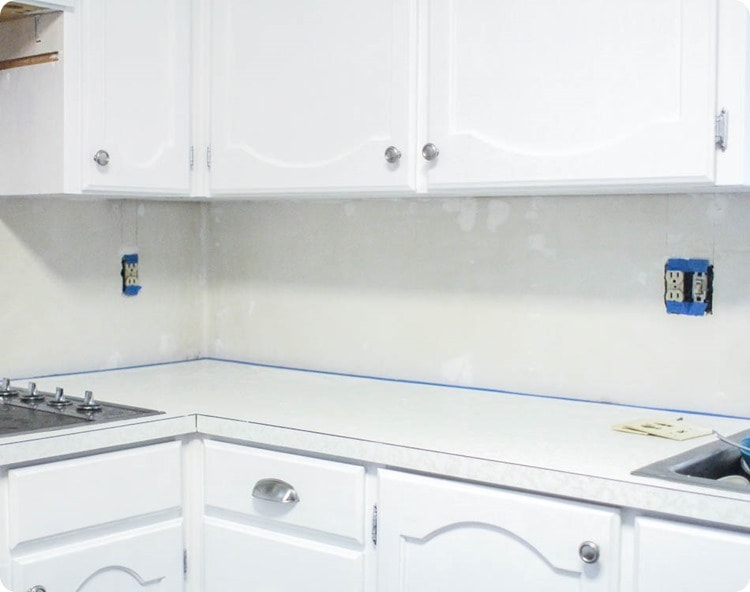 using painter's tape to protect the countertop