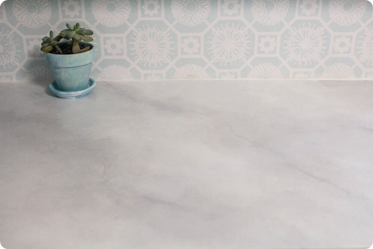 laminate countertop painted like marble and painted blue and white backsplash