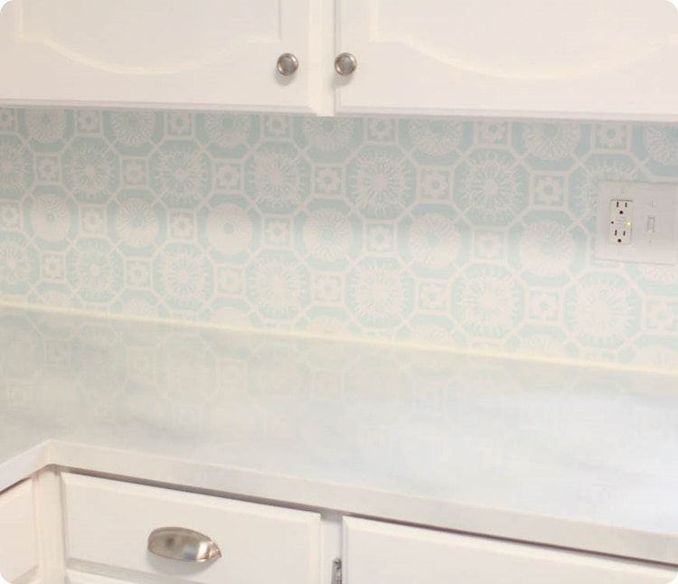 painted countertop, stenciled backsplash, and painted cabinets