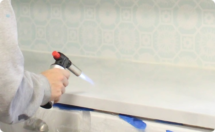 Using a butane torch to remove bubbles from resin finish on painted countertops
