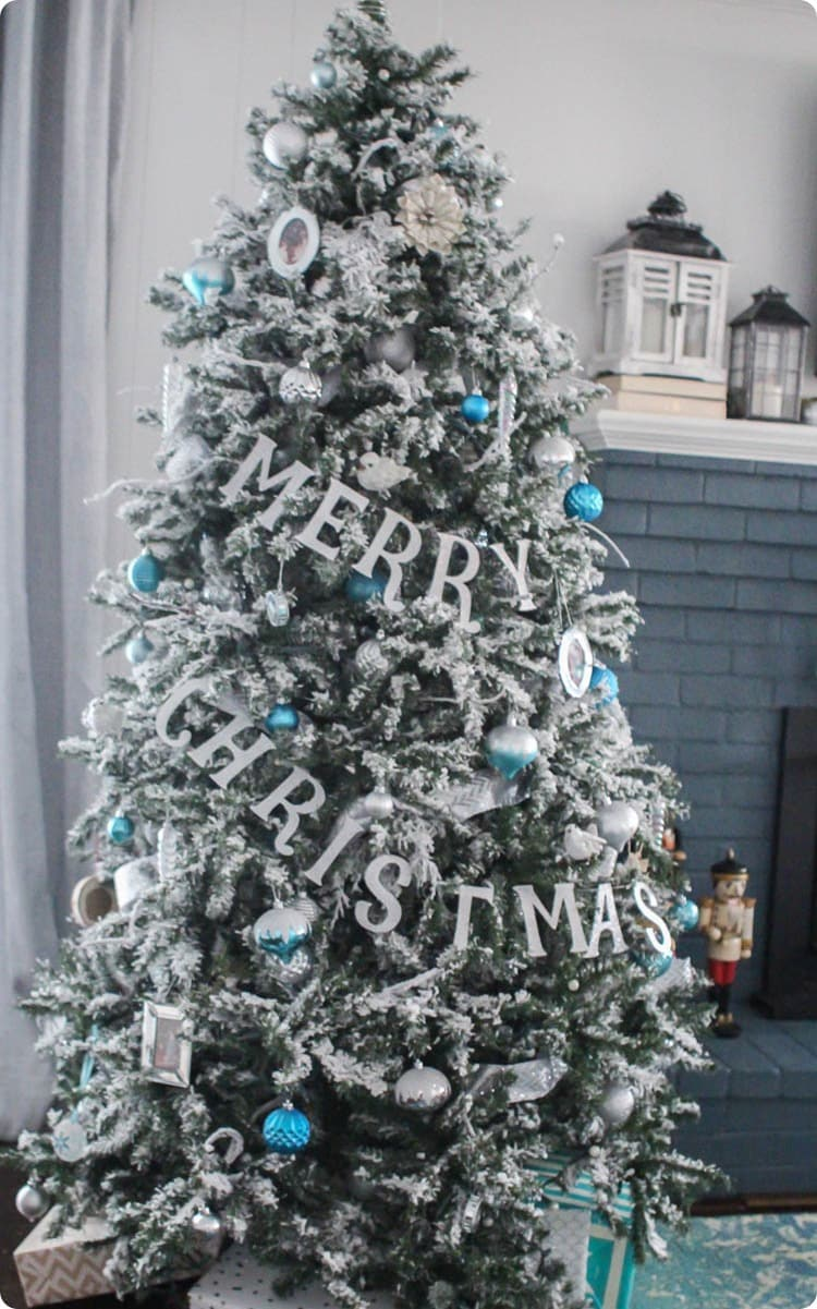 flocked Christmas tree with blue ornaments