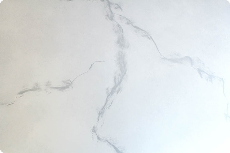 painting gray marble on a white countertop