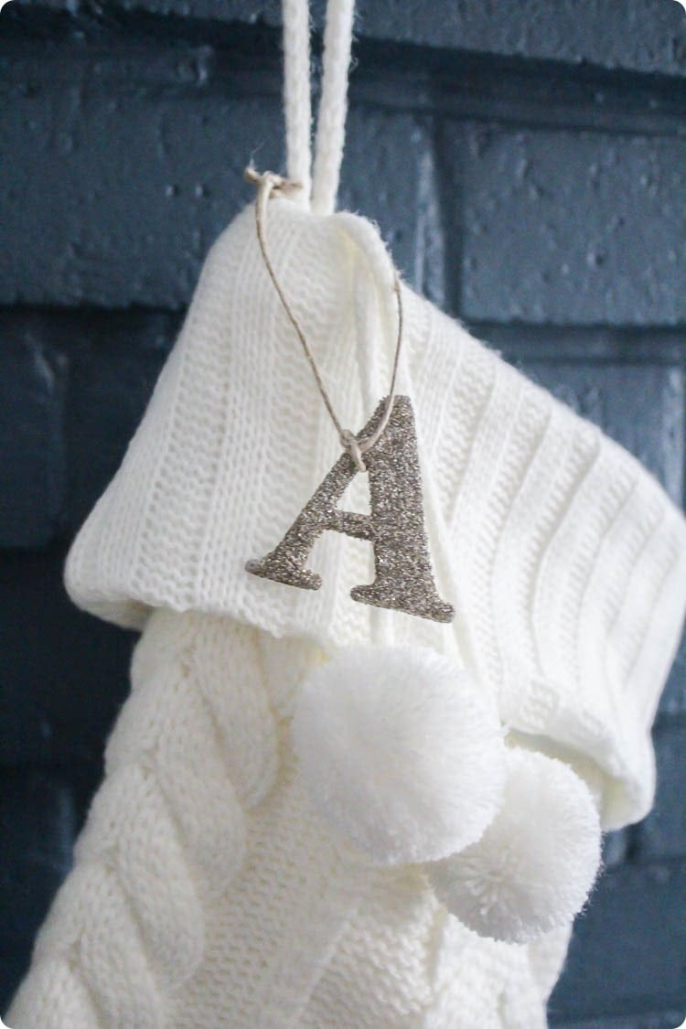white stocking with diy glittered stocking tag.