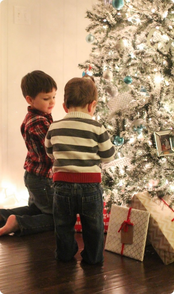kids in front of Christmas tree