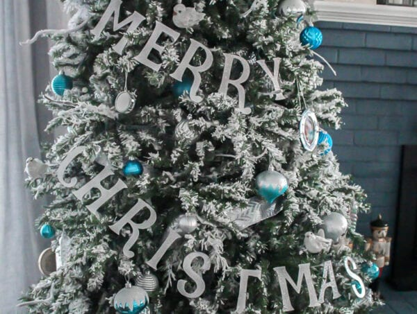 Decorate your Christmas tree with a simple glittery Merry Christmas banner.