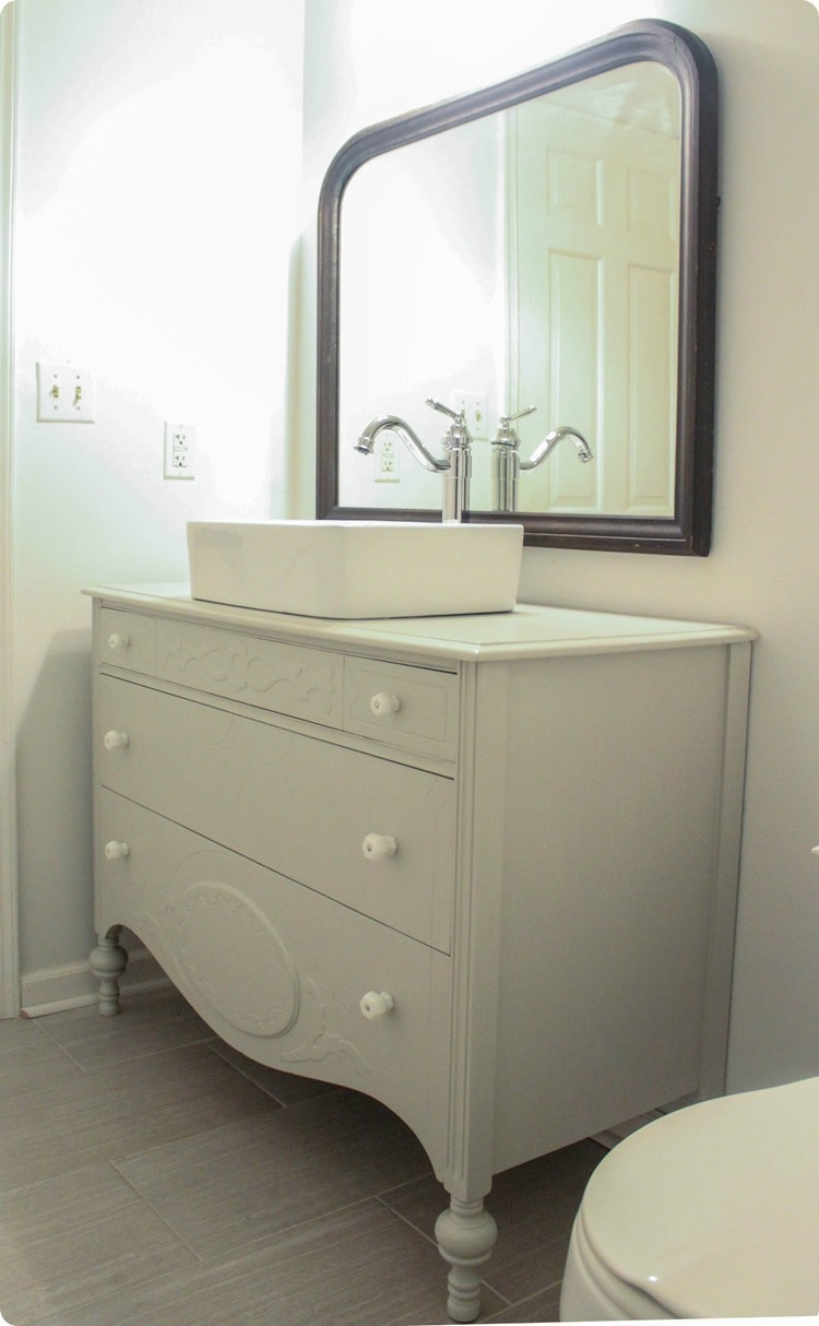 vintage dresser and mirror in bathroom