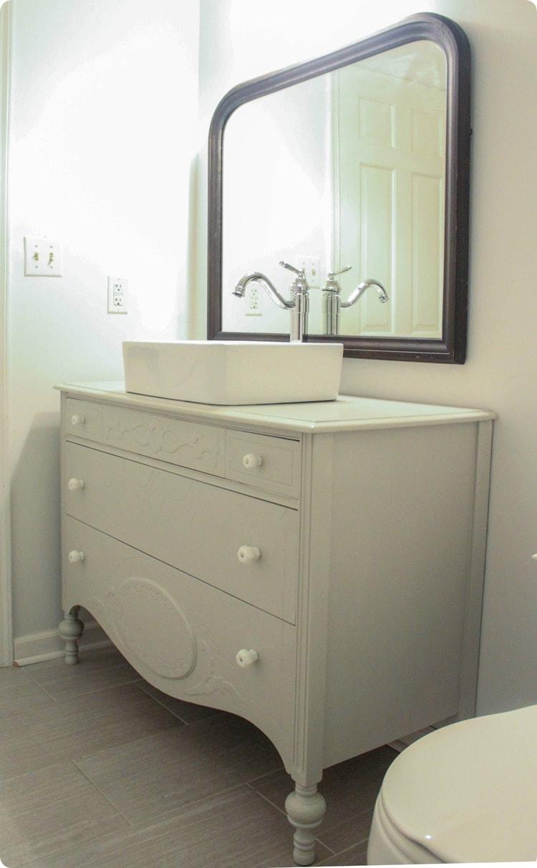 vintage dresser and mirror in bathroom