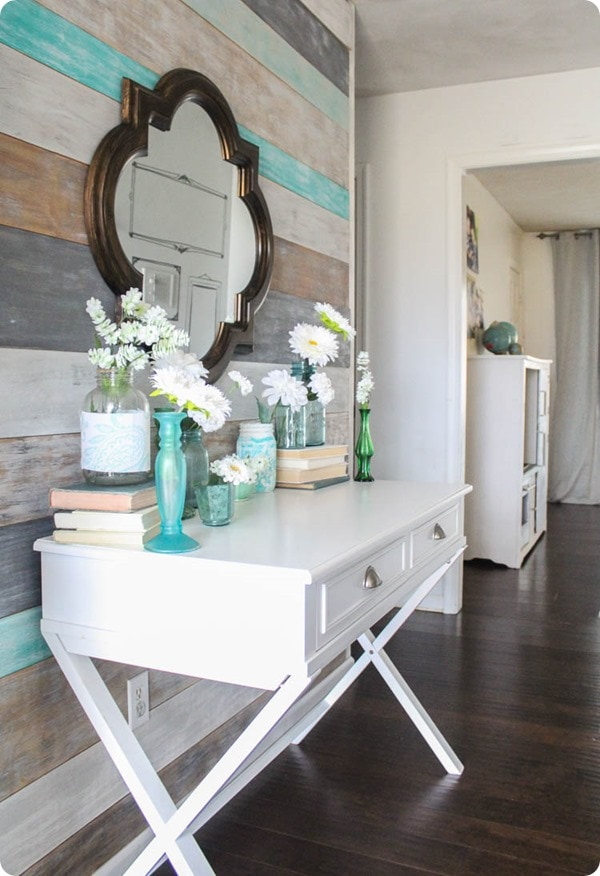 painted plank wall and flowers