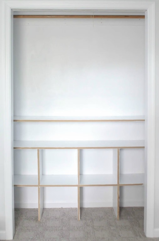 Adding dividers to turn the closet shelves into cubbies.