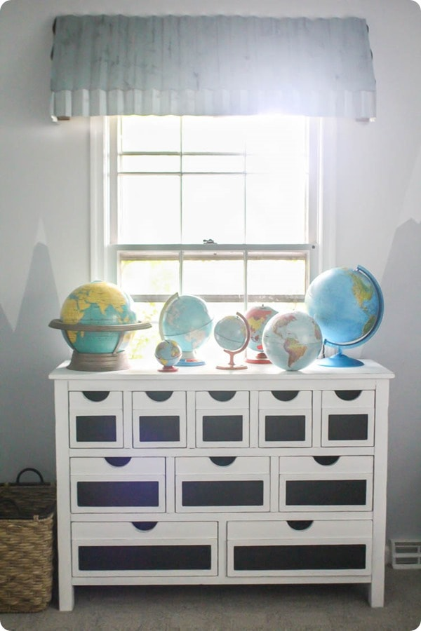 DIY farmhouse window awning with vintage dresser and globes