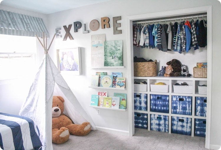 kids room with play tent, gallery wall, and organized closet