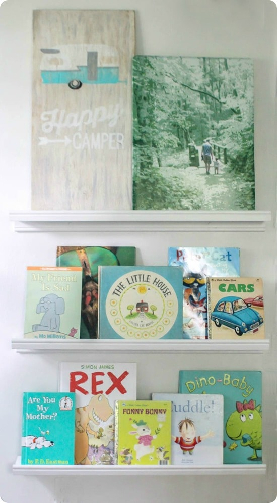 picture ledges with kids books and art