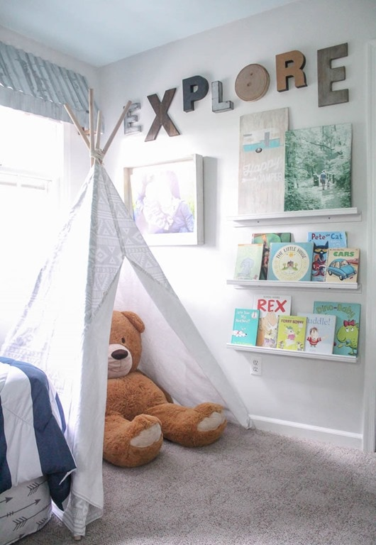 kids room with play tent and huge bear