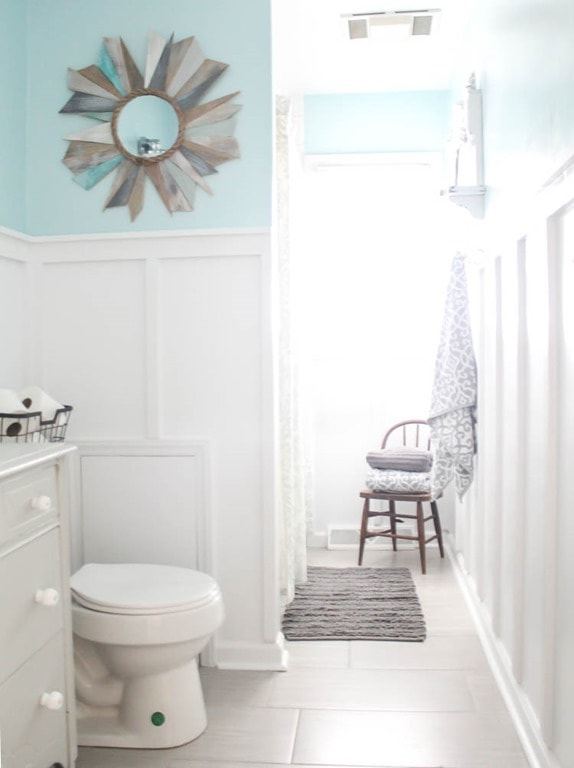 blue and white bathroom with board and batten walls