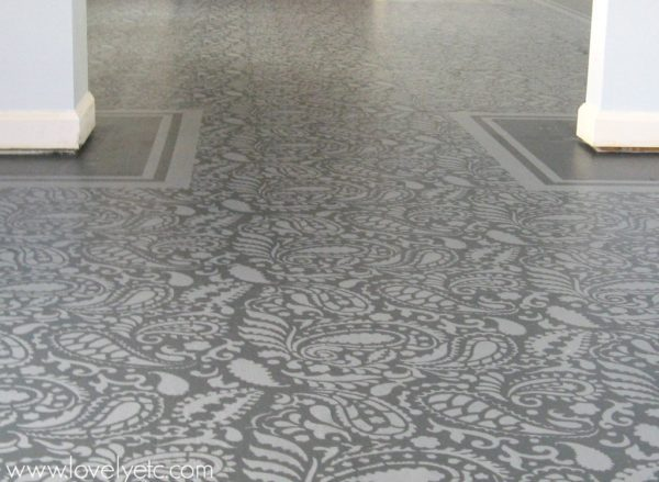 plywood floor painted and stenciled with paisley stencil.