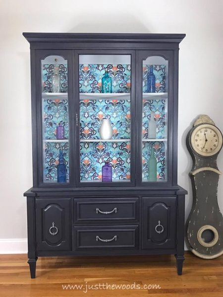 gray china cabinet with decoupage background