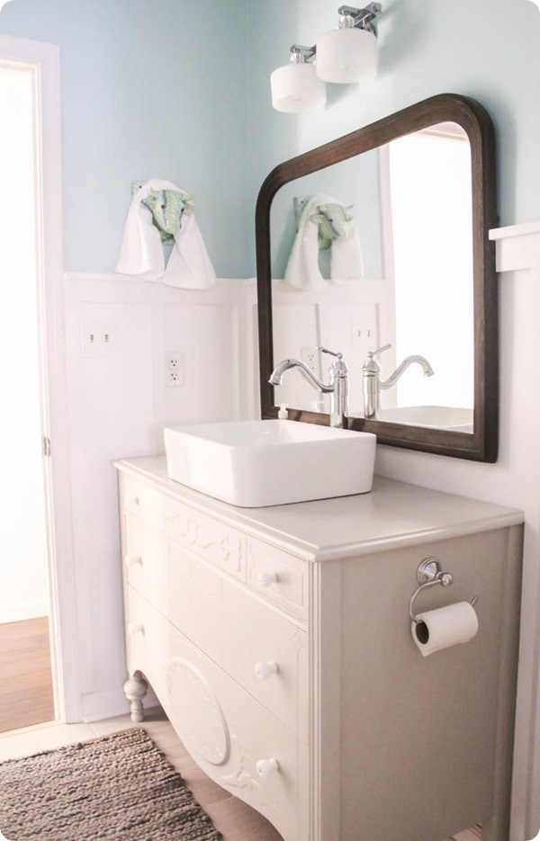 dresser vanity with vessel sink and vintage mirror