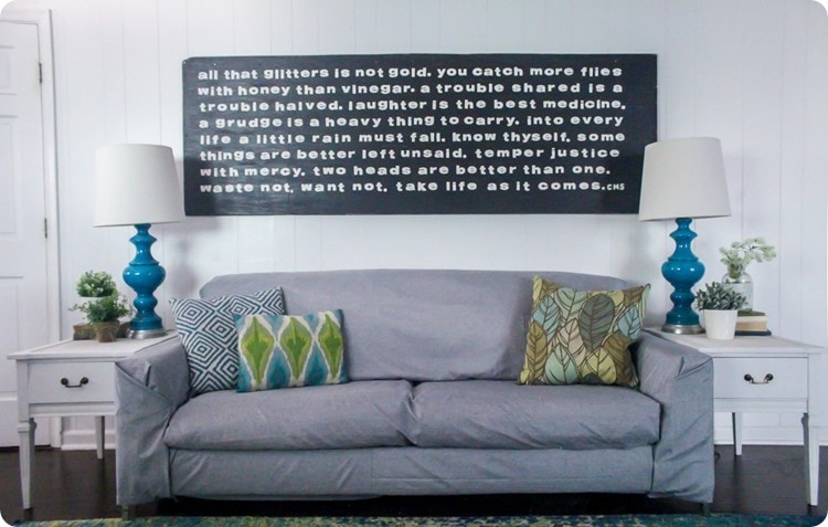 gray couch and oversized wood sign