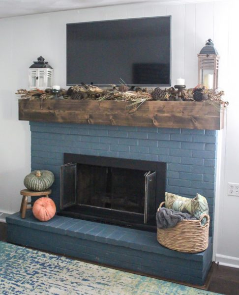 fall mantel with garland and pumpkins