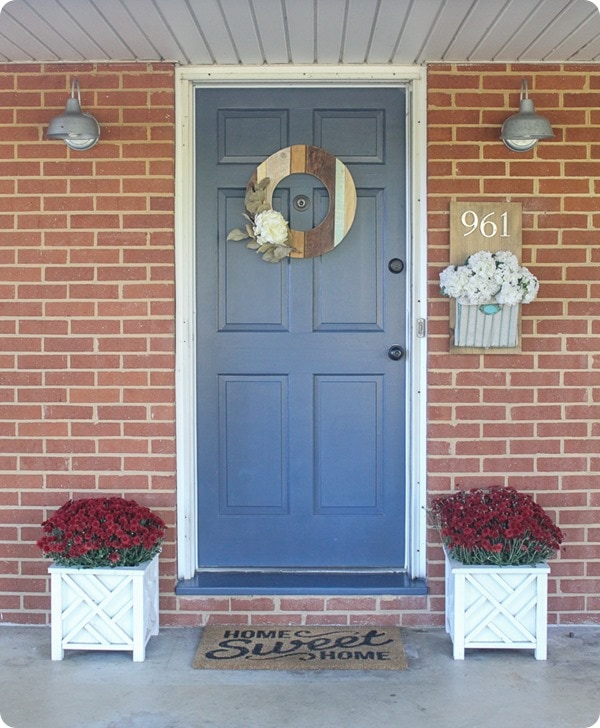 Inexpensive ideas to add curb appeal to an ugly brick ranch or any dated home.  Choosing a front door color for a brick house.
