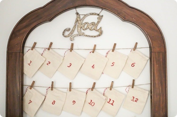 Simple diy reusable advent calendar shown with stamped canvas bags.