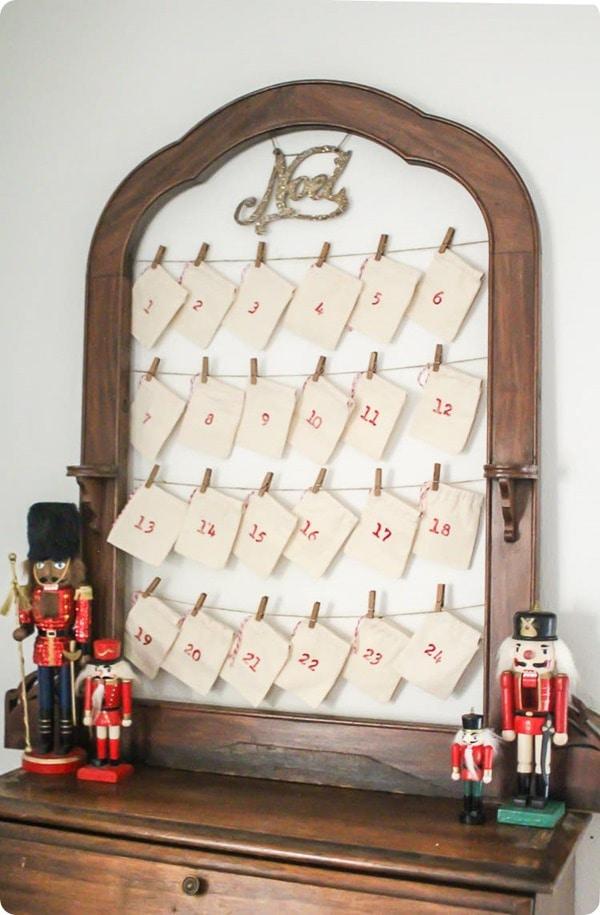 DIY reusable advent calendar on table with nutcrackers.