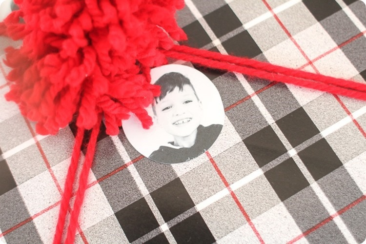 wrapped gift with photo gift tag