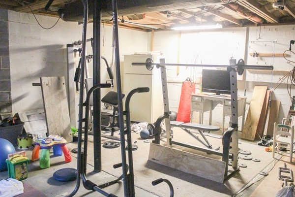 unfinished basement before home gym makeover