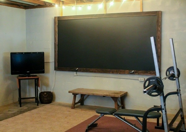 chalkboard and TV in home gym