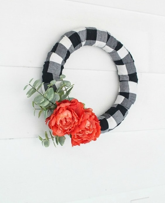Make an easy buffalo plaid modern farmhouse wreath. It's the perfect way to upcycle a plaid shirt or simply buy a bit of buffalo plaid fabric.