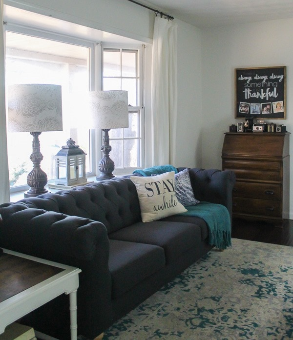 Since Then, Iu0027ve Moved It Across From The Window And Now All Of The Light  Hitting It Makes It Appear Much Lighter. This Charcoal Gray Tufted Sofa ...