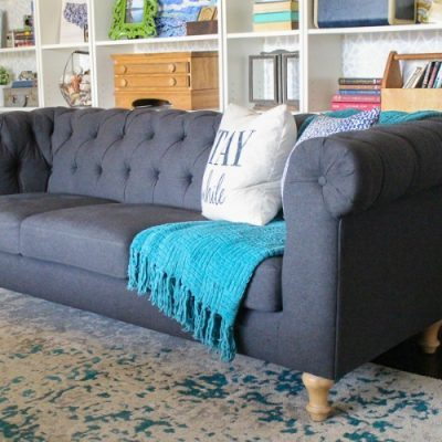 The perfect inexpensive gray tufted sofa