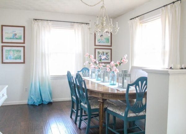 dining room with wood table and blue chairs