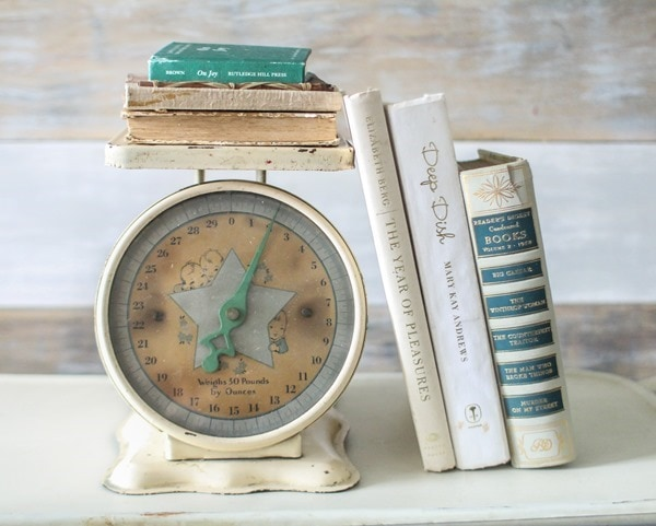 vintage scale and old books