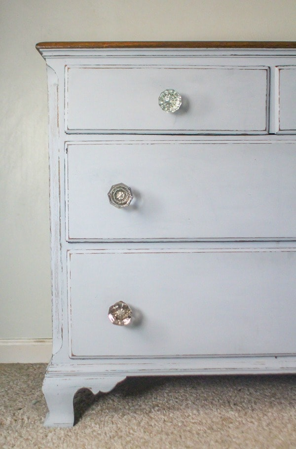 dresser with glass doorknobs
