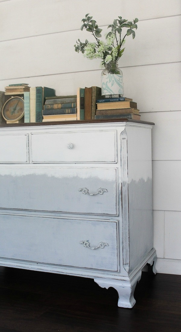 Faded painted dresser in gray and white. A touch or modern farmhouse style plus a touch of boho.