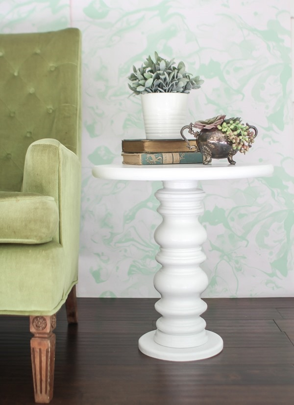 Super easy, inexpensive DIY side table. This cute table is made by upcycling a common thrift store find and it would work in almost any space.