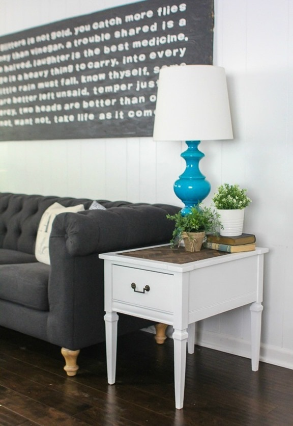 herringbone end table next to couch