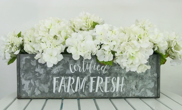 This farm fresh stenciled flower box.