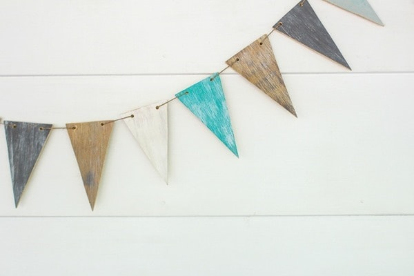 This easy diy wood banner is the perfect way to add farmhouse style to your home or wedding.