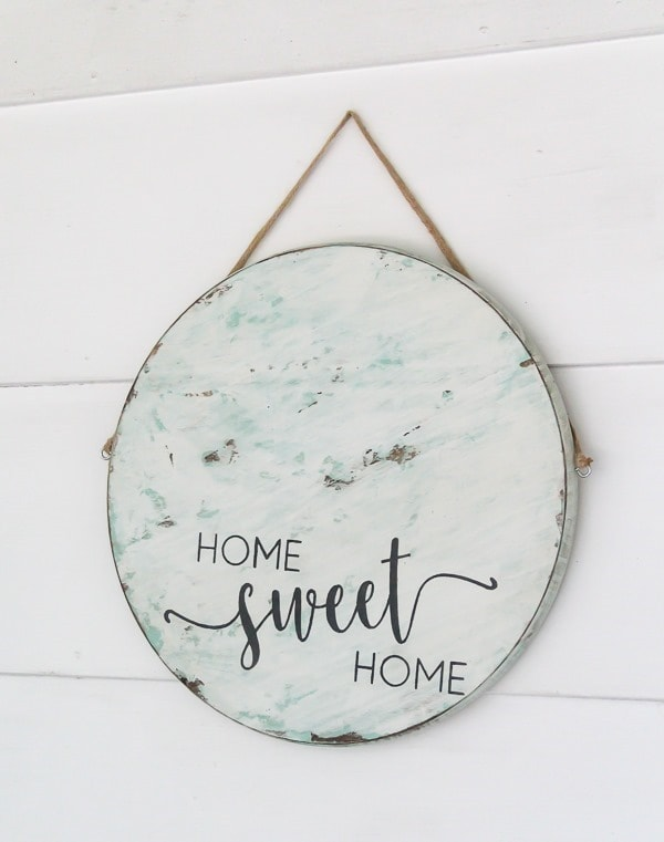 DIY round wood sign. This sign is super easy to make using a home sweet home stencil.