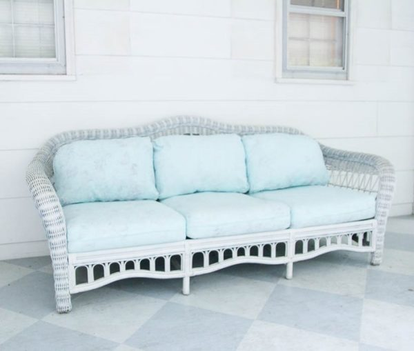 white wicker couch with painted cushions