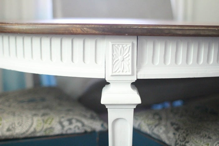 close up of details of white table legs and apron