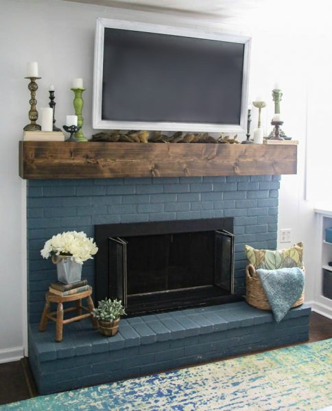 Simple fall mantel decor.  This blue brick fireplace and diy rustic mantel are the perfect backdrop for easy thrifted fall decor.