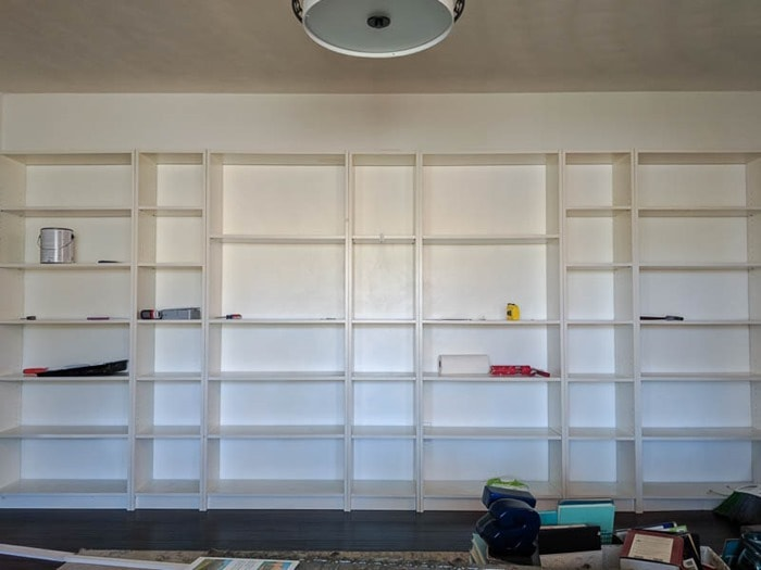 wall of billy bookcases before molding is added