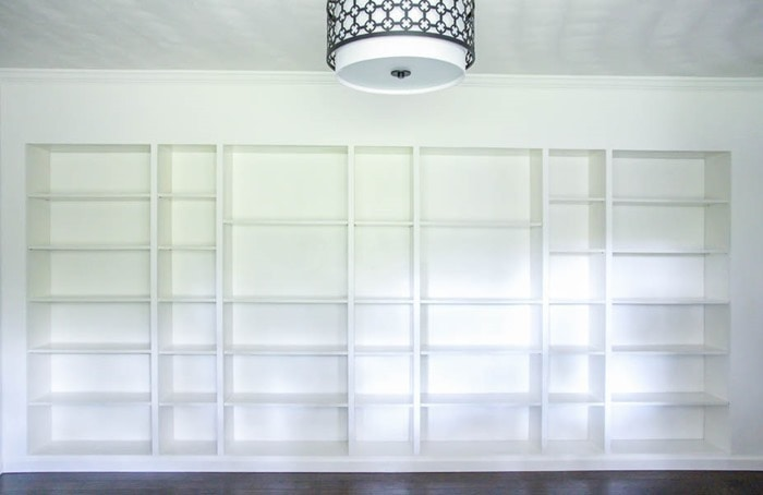 Wall of DIY IKEA billy built-in bookcases