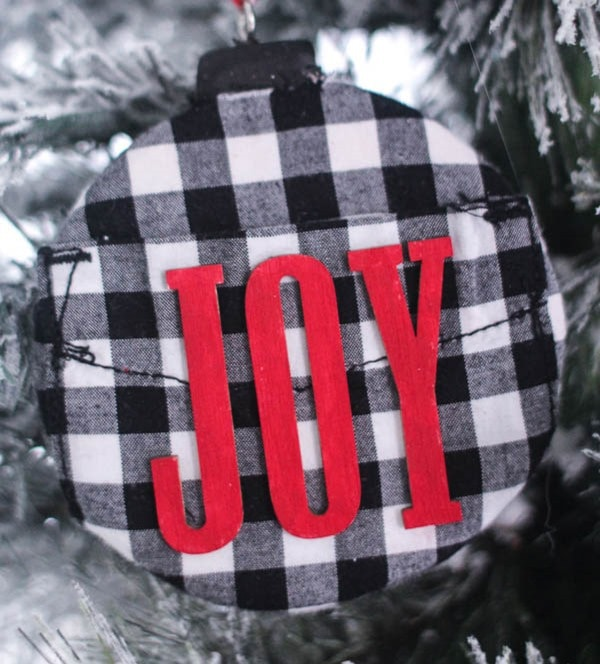diy black and white buffalo plaid ornament hanging on christmas tree.