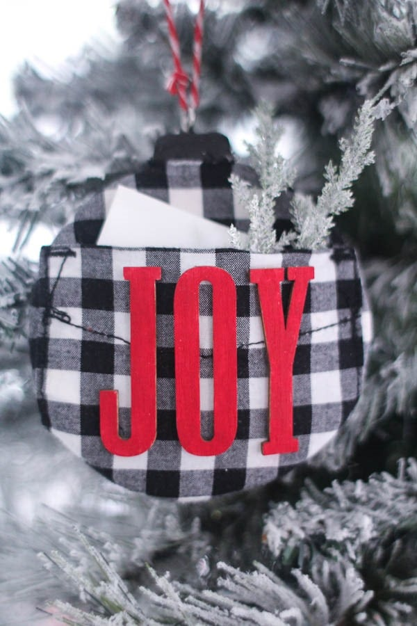 DIY buffalo plaid ornament with letters spelling joy.