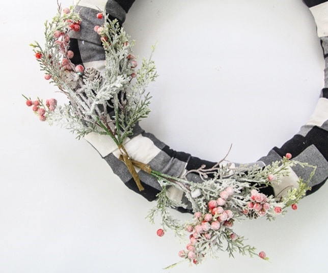 attach the branches to make DIY buffalo plaid Christmas wreath