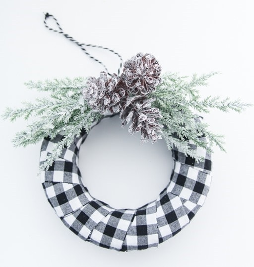 I love buffalo plaid Christmas decor. This adorable buffalo plaid mini wreath makes a gorgeous handmade ornament or you can hang it anywhere else you need a little touch of Christmas.